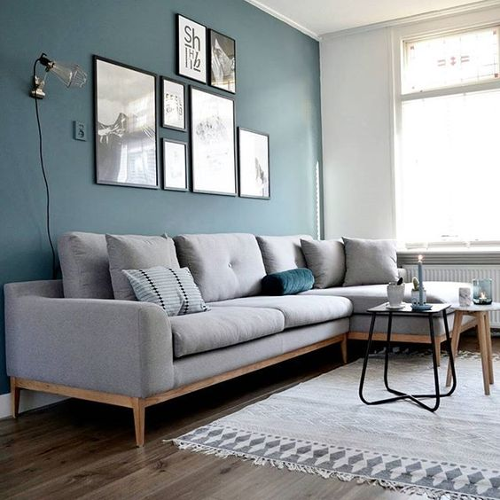 Blue color on the wall combined with a gray sofa