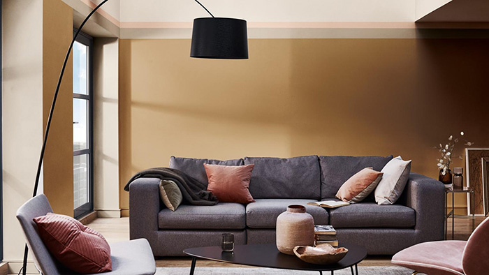 Spicy honey color on the walls combined with a gray sofa