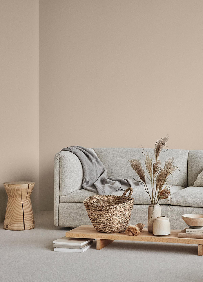 Neutral tones on the walls combined with a gray sofa