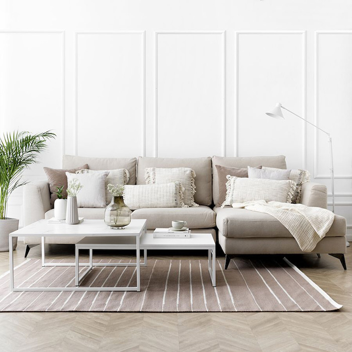 Gray living room with pillows in neutral tones
