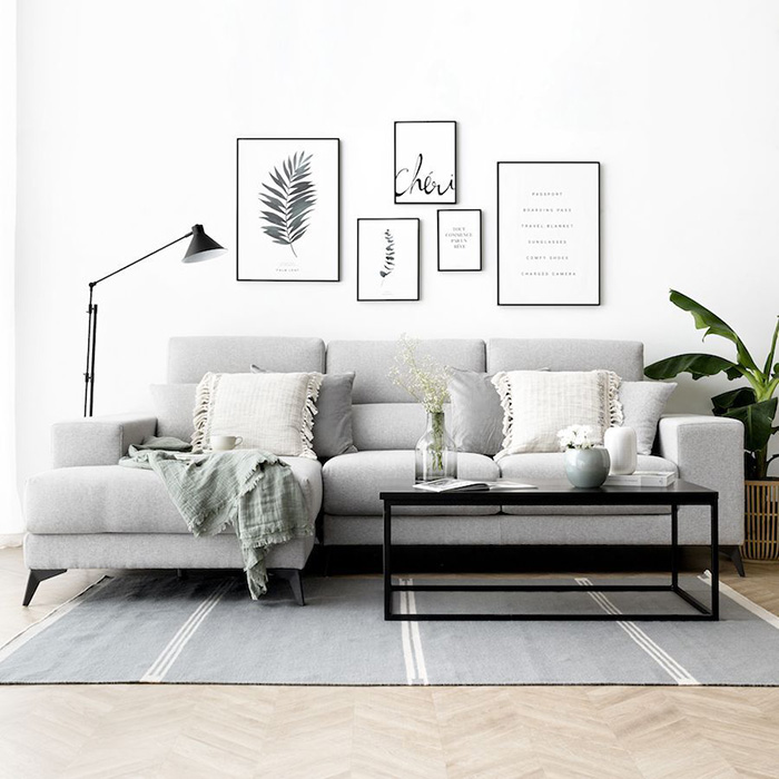 Gray sofa with white and gray pillows