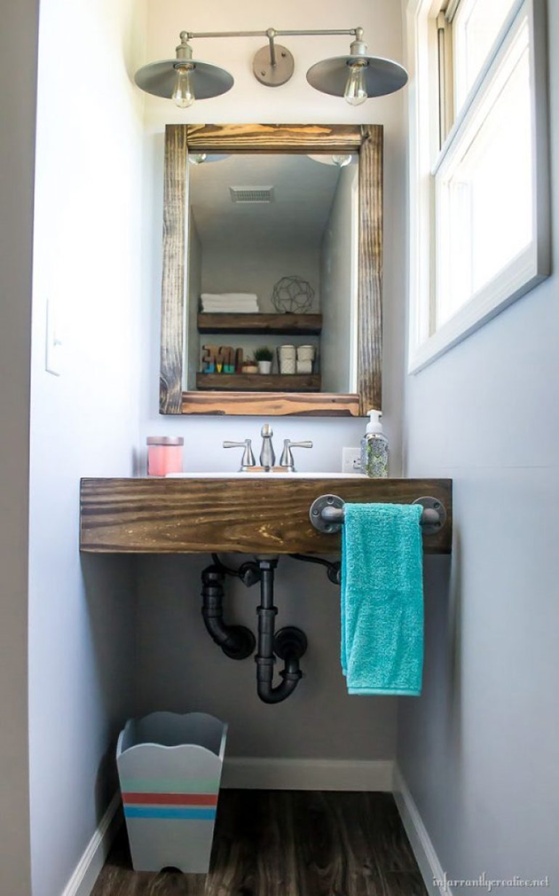 Bathroom cabinet made of wooden planks.