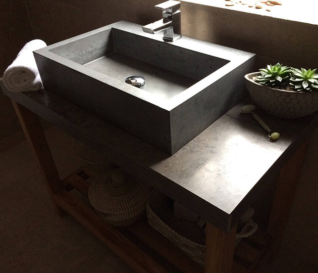 Bathroom cabinet made of concrete and wood.
