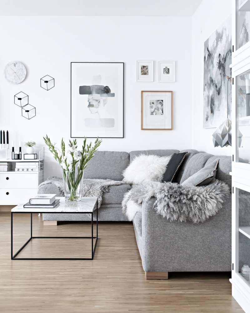White walls combined with a gray sofa