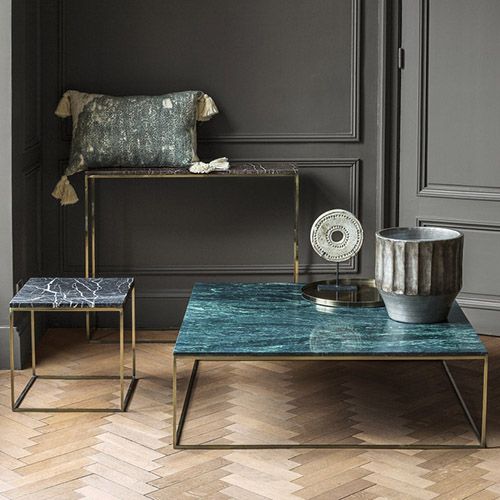 Narrow console made of gold and black marble