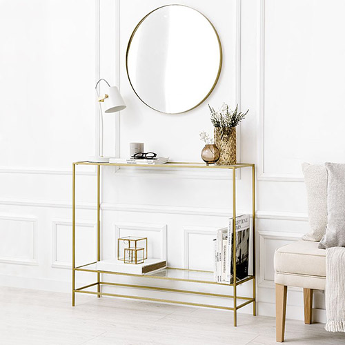 Narrow console in elegant design with gold metal and tempered glass