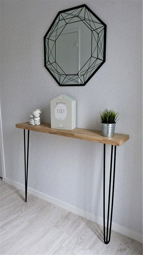 Narrow console in industrial style made of ferrous metal and wood