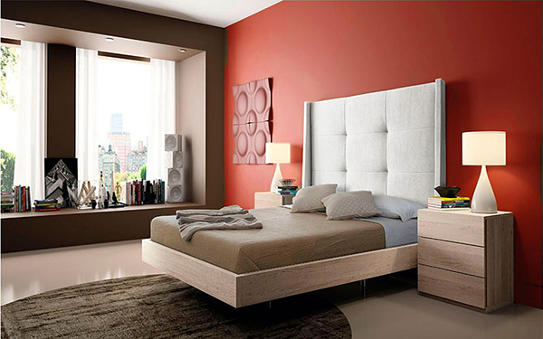 A bedroom that combines red and brown