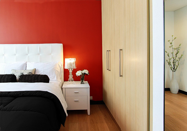 A bedroom that combines red and black