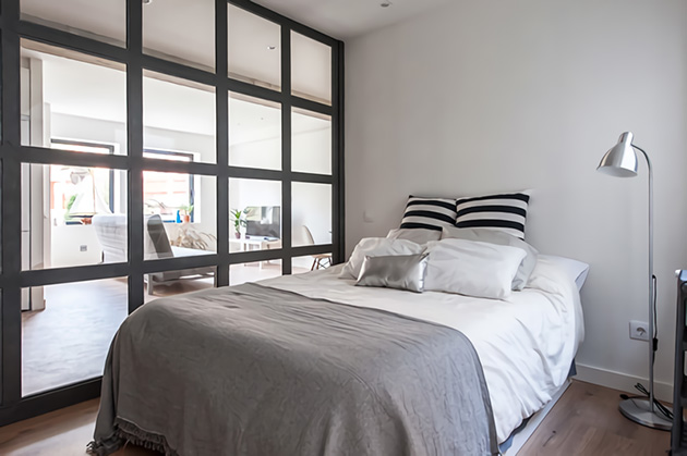 Small room with metal wall and glass panels