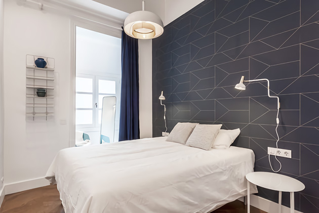 Modern small room with geometric wallpaper