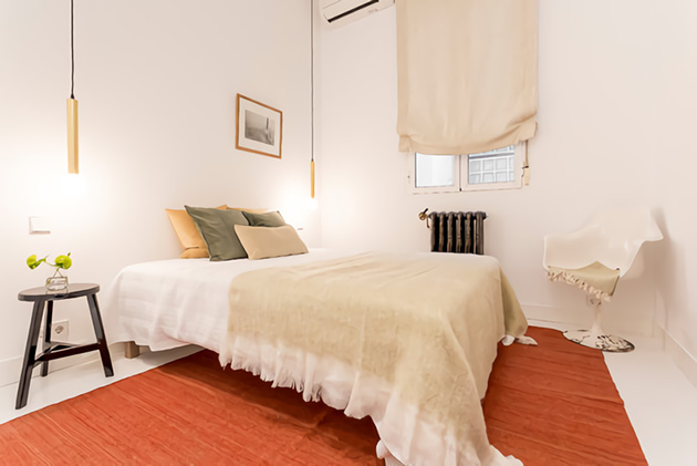Small white room with red carpet