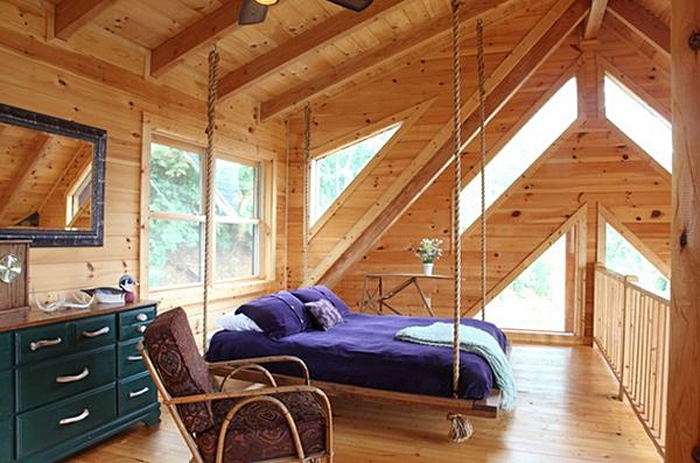 Hanging bed attached to the ceiling beams