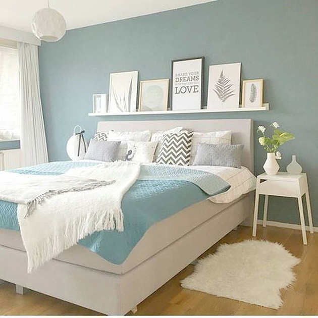 The bedroom is painted in a relaxing blue color