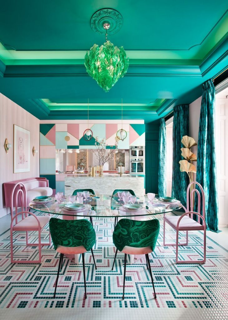 A bold kitchen that combines turquoise and green, with pink tones