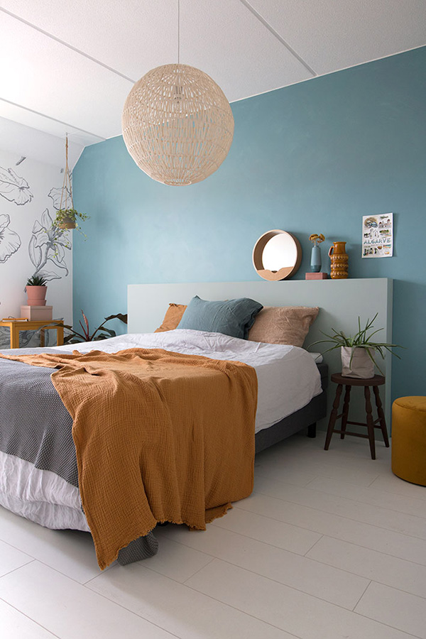 The bedroom is painted blue.  Relaxing color