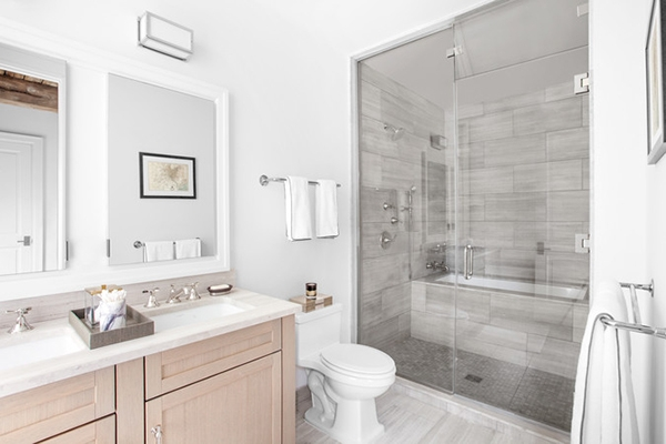 Bathroom in gray and white tones and natural wood furniture