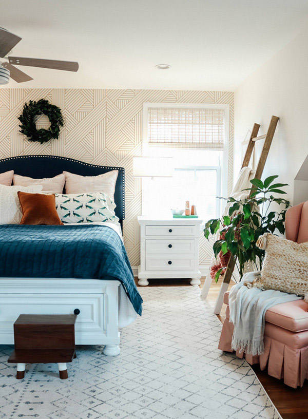 Cheerful and beautiful double bedroom with blue textiles and wallpaper