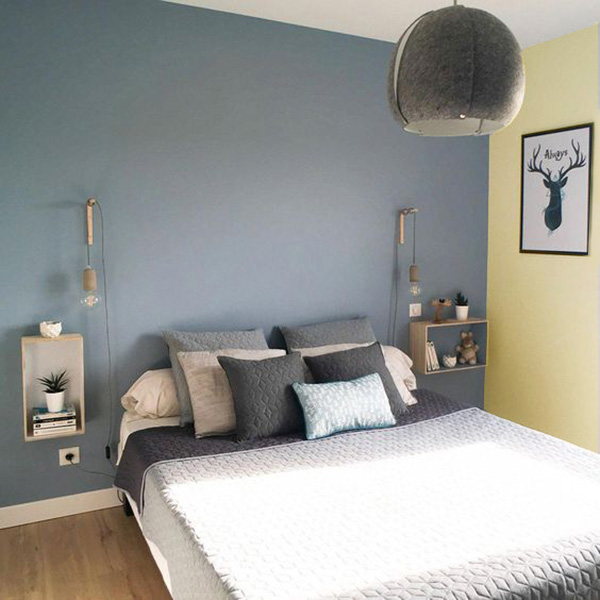 A bedroom that combines beige and blue walls