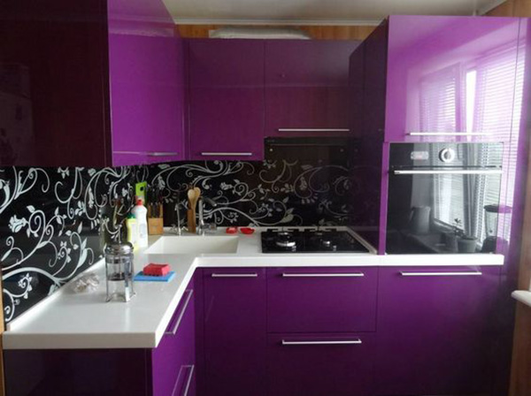 A kitchen that combines black and purple