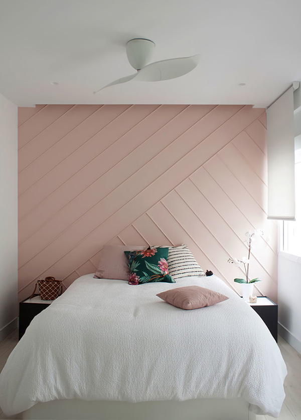 The bedroom is decorated in pink and white