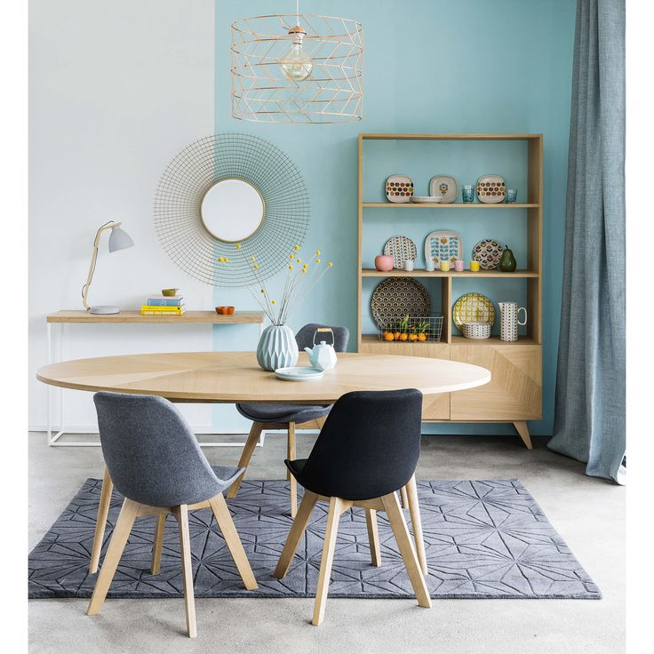 The dining room of the Maisons du Monde is painted light blue