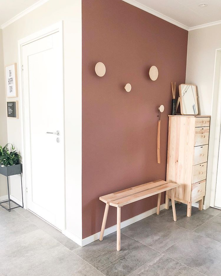 Hallway painted in terracotta color, color trend