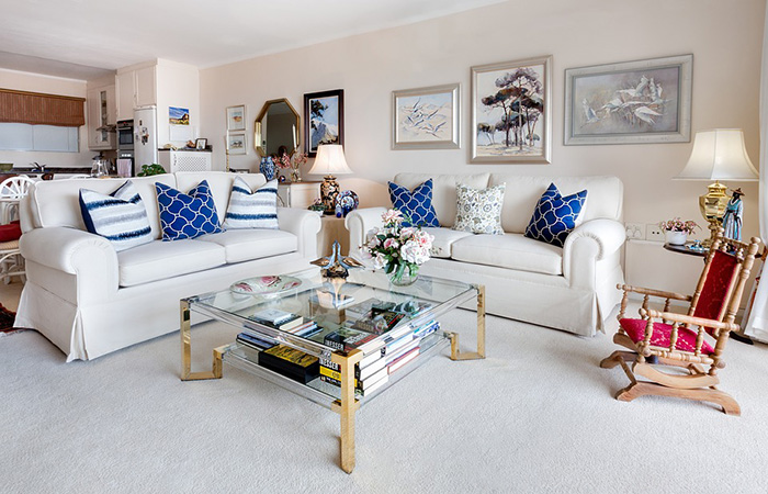 Sand-colored living room with blue accents on the pillows