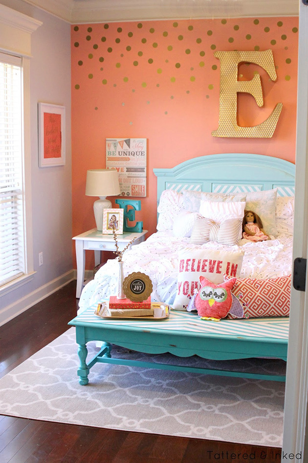 The bedroom is painted peach on the walls and azure blue