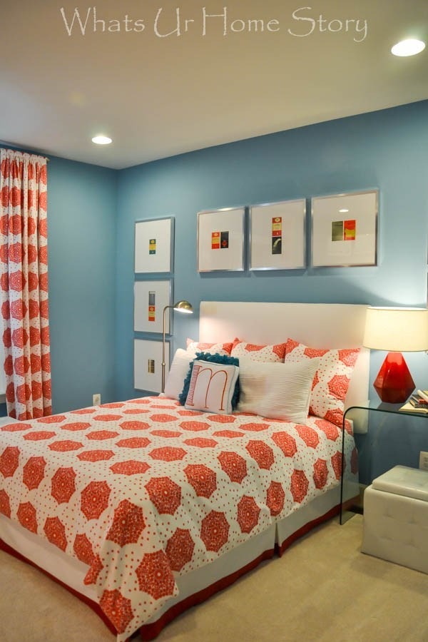 A bedroom that combines blue on the walls with orange