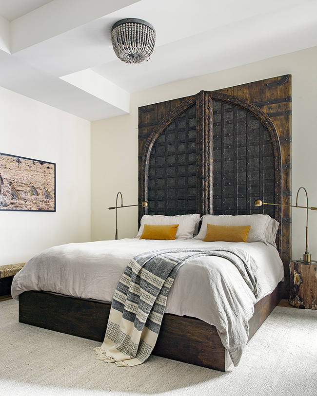 Idea for decorating the wall above the bed: Antique door
