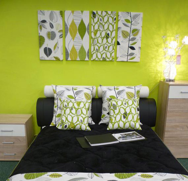 A bedroom that combines green with black