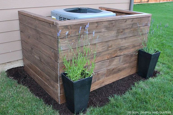 Wooden construction to hide air conditioners in the garden