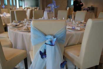 Chairs decorated for the first communion