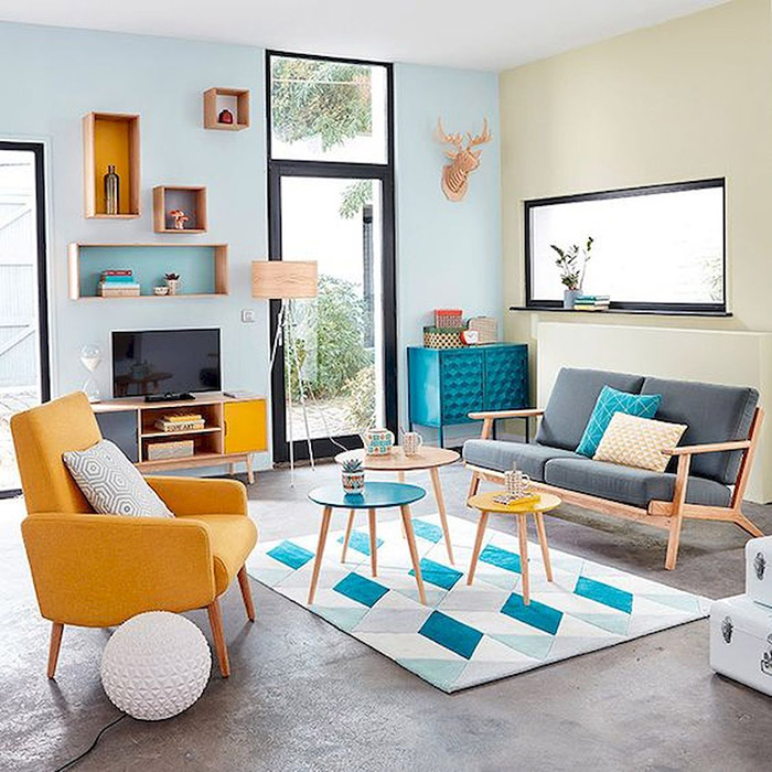 The living room is painted and decorated in pastel blue and pastel beige tones