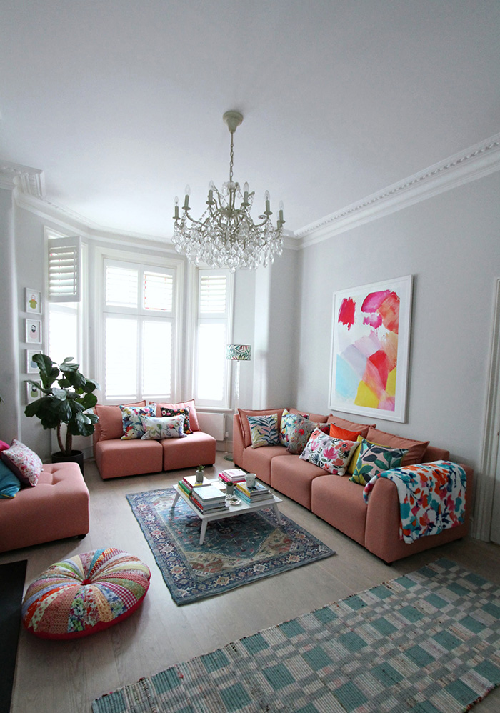 The living room is painted and decorated in pastel colors
