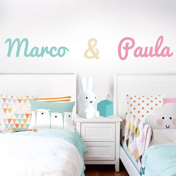 Stickers with the names of the children to be put on the bed