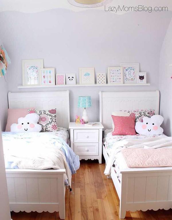 Shared bedroom with two beds painted lilac